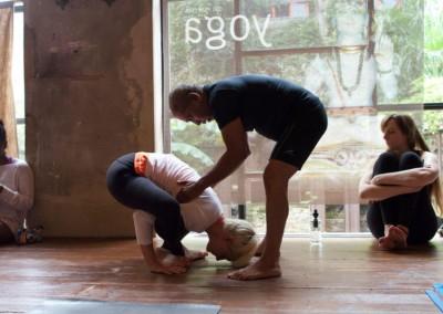 Manju Jois adjusting a student